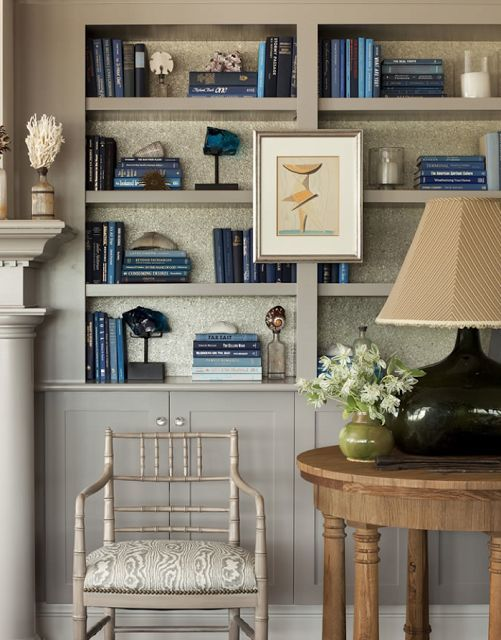 color + detail beautiful vignette and bookcase styling with blue and gray