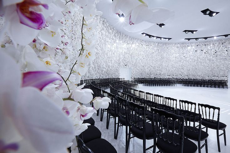 Designer Alexandre de Betak outfitted the walls of Christian Dior's Fall/Winter 2014 couture fashion show with thousands of fresh white orchids.