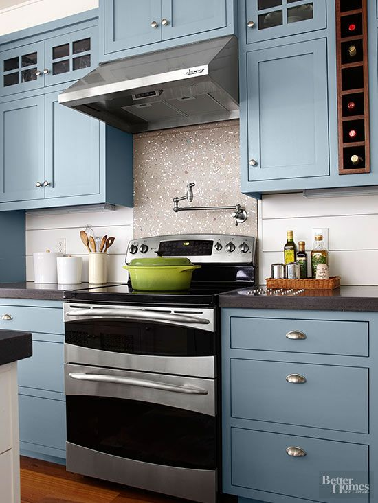 Soothing ocean-blue cabinets bring coastal comfort to a kitchen. Contrasted with white shiplap siding and concrete counters, the beachy blue hue takes center stage in this kitchen without overwhelming. Paint Color: Valspar Paint, Blue Twilight 5001-1C.