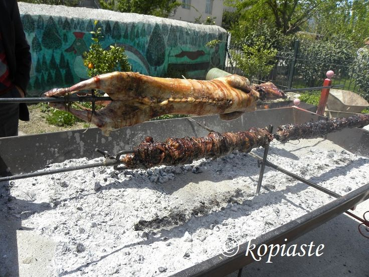 Ovelias is a Greek Easter tradition where a whole lamb is roasted in huge roasters in their yards. #Greek_Easter #lamb_on_the_spit #Greek_food #ovelias