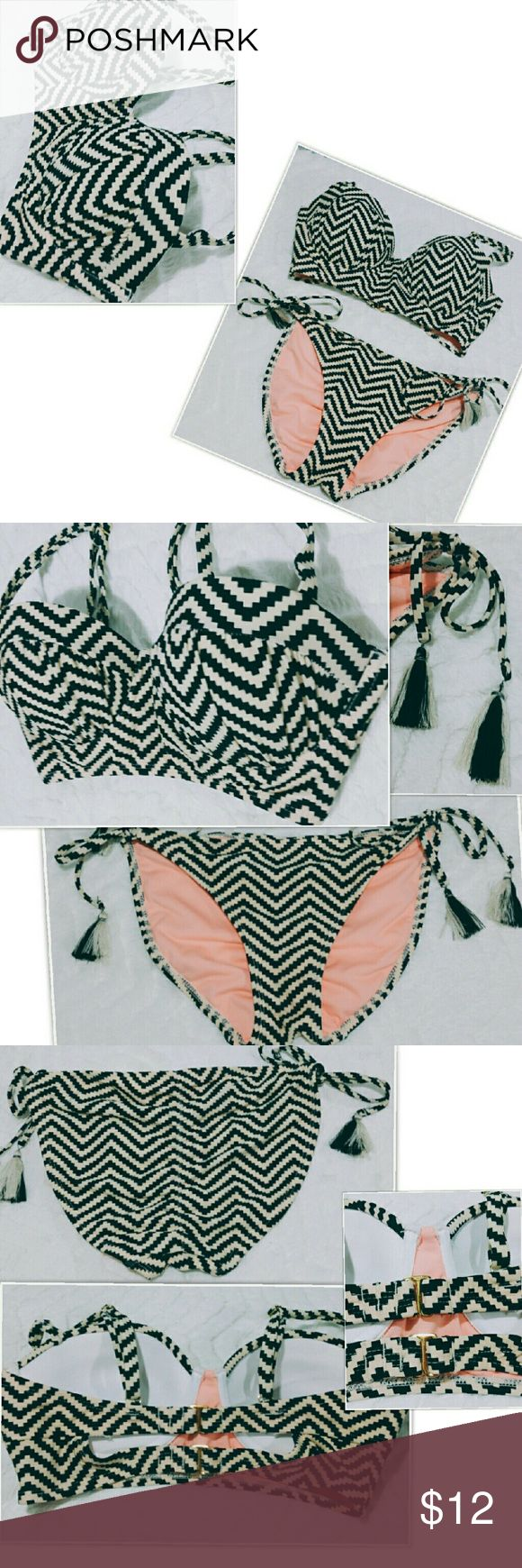 NWOT Bikini Super cute bikini swimsuit by Ninety Nine. Top and bottom are both size M. Tags were cut out of top and then i decided i wanted another suit so i never wore this one. Top has padding and pushup with adjustable straps. Bottom is tie on each side. Colors are black and cream with peach on inside of suit. Ninety Nine Swim Bikinis