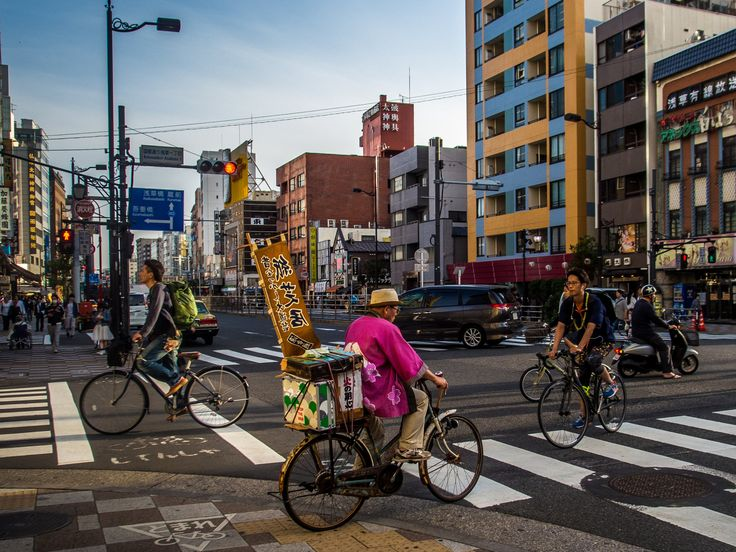 A kamishibai (pre-war storytelling with picture boards for children) entertainer crossing Kokusai Dori with his bicycle and the tools of his art. One more touch of nostalgia of those still abound in Asakusa. #Asakusa, #kamishibai, #Kokusai May 8, 2016 © Grigoris A. Miliaresis