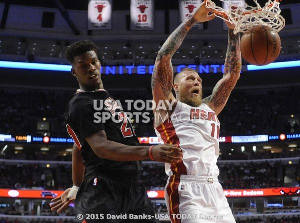Jan 25, 2015; Chicago, IL, USA; Miami Heat forward Chris Andersen (11) dunks over Chicago Bulls guard Jimmy Butler (21) during the second half at the United Center. The Miami Heat defeated the Chicago Bulls 96-84.