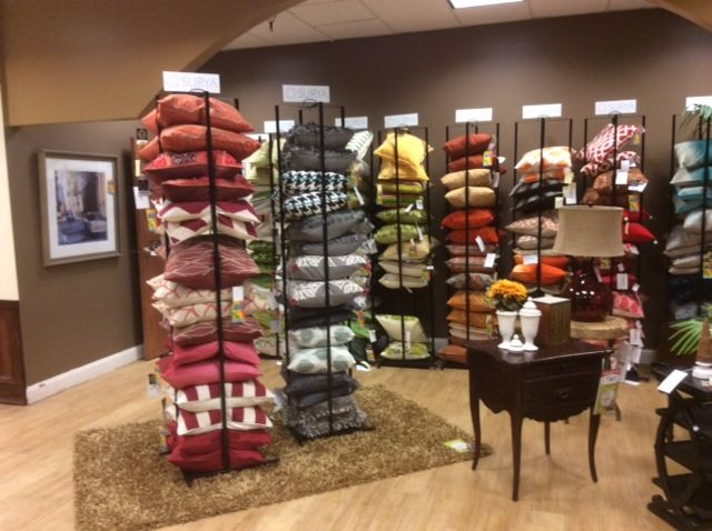 @Pilgrim Furniture City  loves our new Pillow Tower display rack. The space-saving tower holds up to 20 Surya down- or poly-filled pillows – significantly increasing the number and variety of pillows that can be displayed within a retail space.