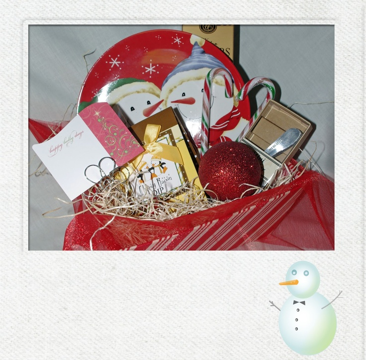 Snowman Plate Basket.          A festive Christmas basket featuring a snowman plate, mini spreader, dips, crackers, cookies and treats.  CB006  $29.99