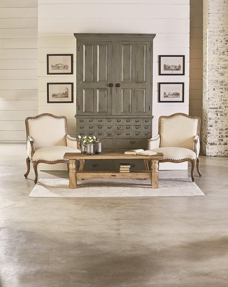 Joanna Gaines' Magnolia Home Furniture line is in stock at both #CityHome locations, including Joanna's Card Catalog Armoire in Patina finish!