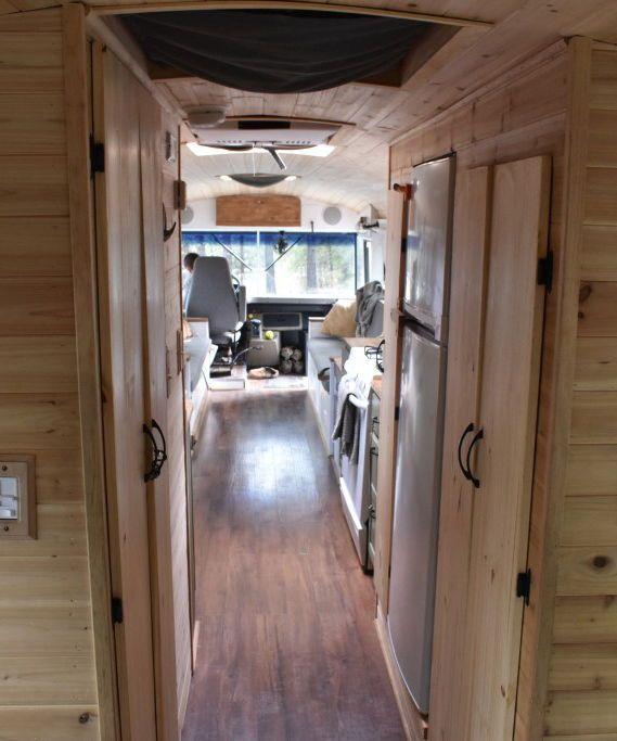 The bus offers approximately 140-square-feet of living space and includes sleeping space for six, a 6-foot kitchen table, full size range, 10.4 cu.ft. refrigerator, and a wet bath with composting toilet.