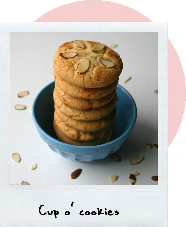 Honey Almond Flower Cookies  Makes about 4 dozen cookies.    Source: My own imagination.    1 cup unsalted butter, room temperature  1 cup granulated sugar  1 egg  4 tbsp honey  2 tsp almond extract  3 cup flour  1 1/2 tsp baking soda  1/4 tsp salt    Slivered almonds for garnish  1 egg yolk for egg wash  1 tsp water for egg wash