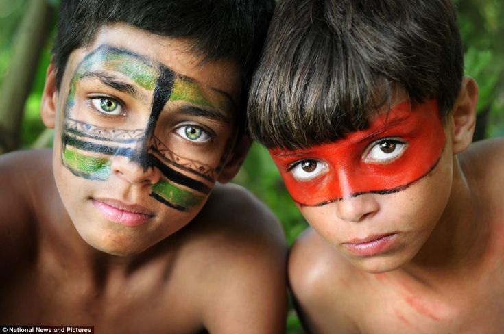 Elaborate tribal wear: 'The feathers in the boys' headdresses are made from a Macaw bird, ...
