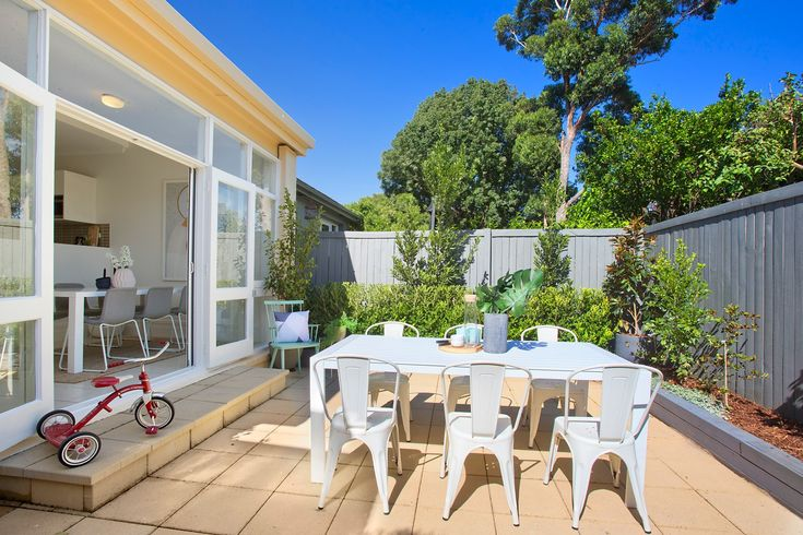 Sunny alfresco dining, BBQ courtyard, white outdoor setting, tricycle, Pilcher Residential