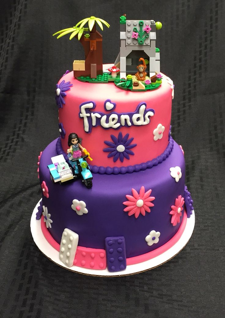 I could do this as £75 for 2 tier or £45 for single tier but would need you to provide the Lego bit for the topper. I can add characters for £7 each or you could provide them. I would put the cake on a larger board and have Happy Birthday etc written on the board.