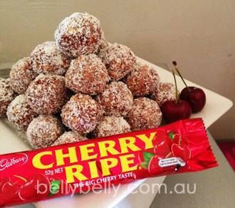 CHERRY RIPE BALLS !   INGREDIENTS:  5-6 cherry ripe bars  1 packet of Nice / choc ripple biscuits   2 tablespoons cocoa  1 can condensed milk  Desiccated coconut    INSTRUCTIONS:  Place cherry ripe bars, biscuits and cocoa in a food processor and blend. Add condensed milk, roll into balls, covering with coconut. Can add red food colouring to the coconut. Leave them to set in the fridge.
