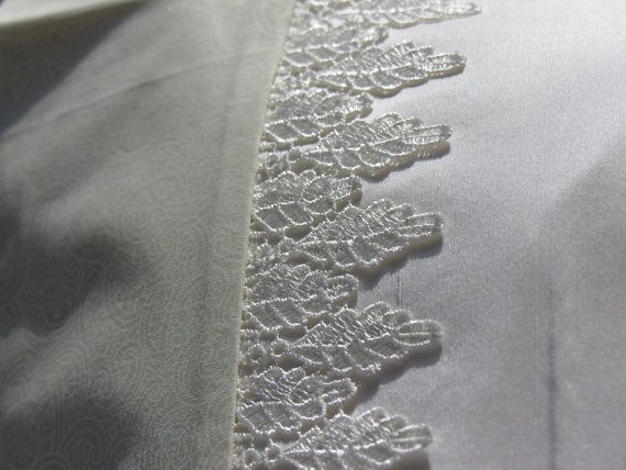 Pure silk charmeuse pillowcase with lace trim (etsy).