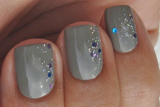 Subtle Glitter Nail Art. Muted polish, with small speck glitters on the