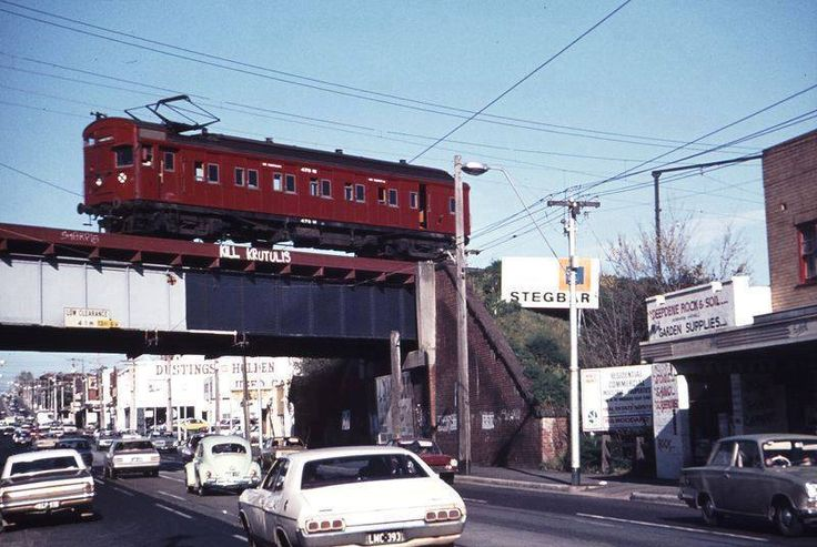 Hartwell rail bridge above Toorak Road, single Tait red rattler carriage which ran from Alamein to Camberwell.  Peter Ferrigno photo.