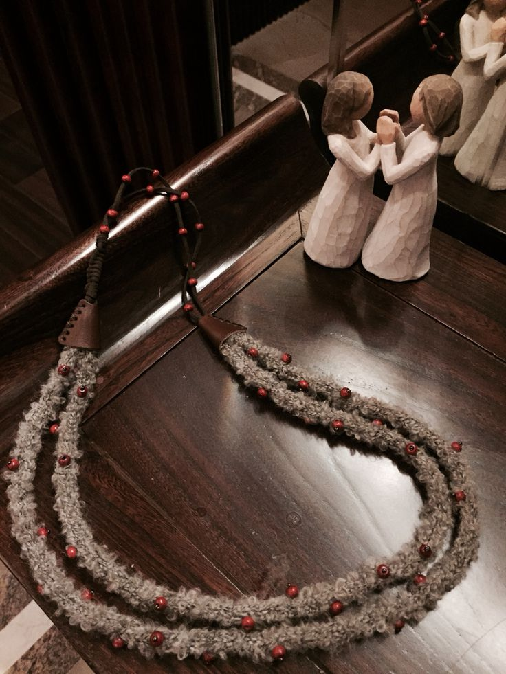 Handknitted wool necklace with leather and wooden beads