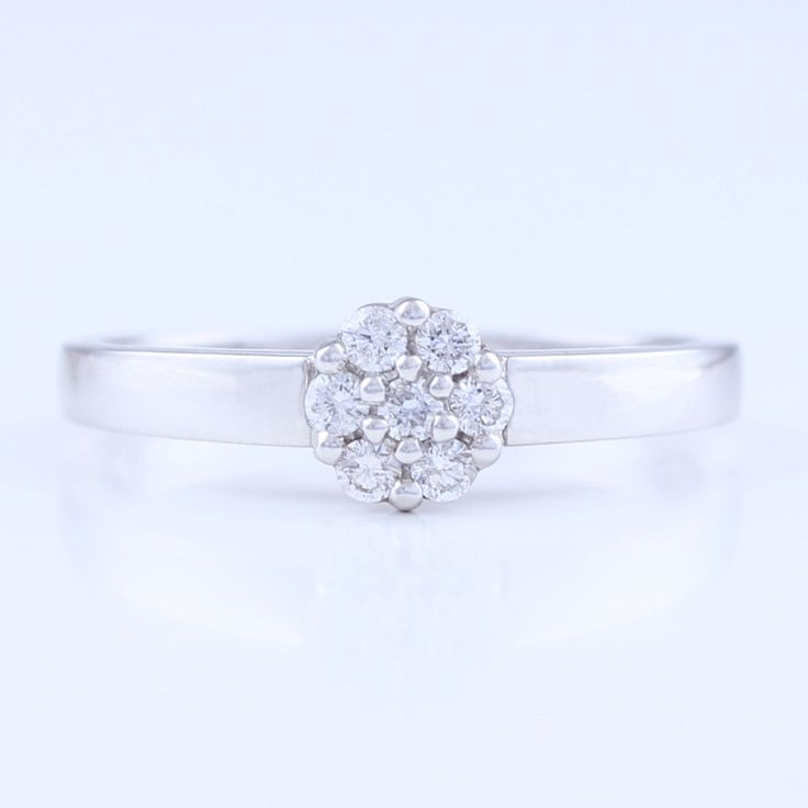 Cluster Engagement Ring was $1,450 now $1,290. 9 ct White Gold, Round brilliant 0.17 cts TDW G-H SI-I1  SKU: 10122. This ring is available online or in store at 98 Richmond Road, Grey Lynn. Available in different diamond weights, gradings and metal, please enquire for prices. All prices are in New Zealand Dollars including gst. This item ships within New Zealand only. Free delivery NZ wide. #diamonds #NZMade