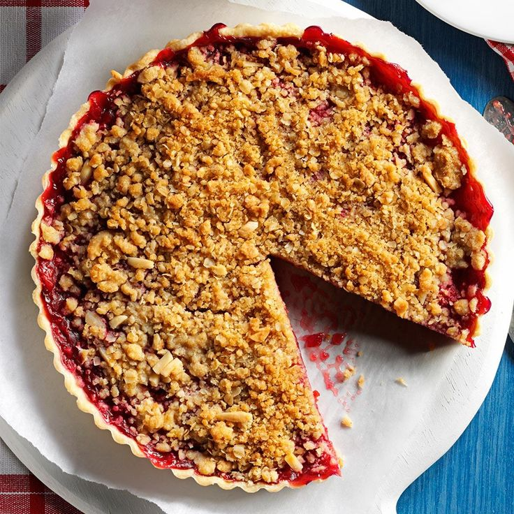 Cherry-Almond Streusel Tart Recipe -Brimming with fresh cherries and topped with a crunchy streusel, this tempting tart is a great way to end…