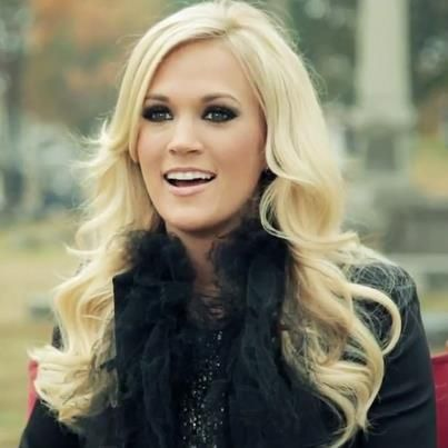 Carrie Underwood, love how she can pull off the super pale hair and smokey eyes while still looking innocent.