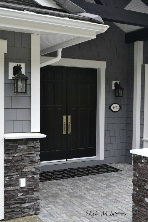 exterior of home with chelsea gray painted shakes, black painted double front…