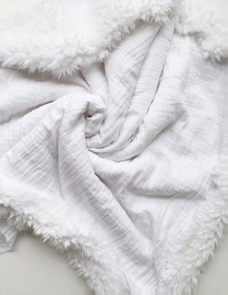 Lightweight and cozy, the White Gauze Blanket is a timeless staple for your nursery and home. FEATURES: ~ 100% Cotton Double Gauze ~ Amazingly soft white faux fur ~ Topstitched for added durability Wh