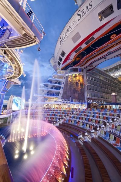 #1 big-ship honeymoon cruise for cruise fanatics. Um, this floating resort has water shows with aerial acrobats!