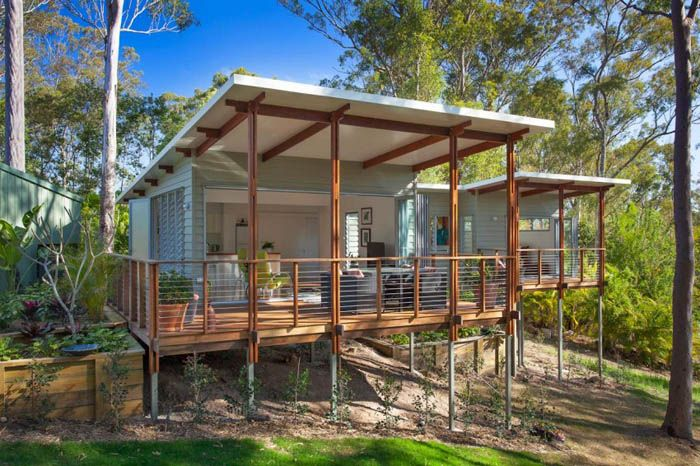 "This 592 sq. ft. home in Queensland, Australia might be called a ""granny flat"" because of its practicality. It seems to float among the trees. 