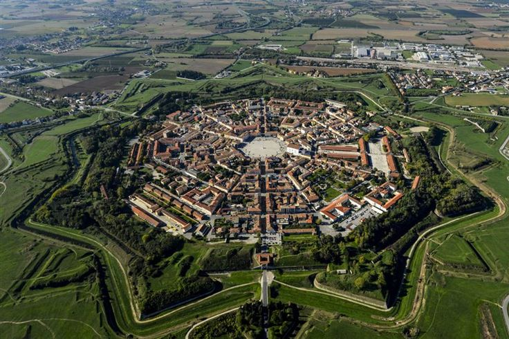 Palmanova, Italy a truly beautiful fortress town. From the air it looks like a snowflake or star.
