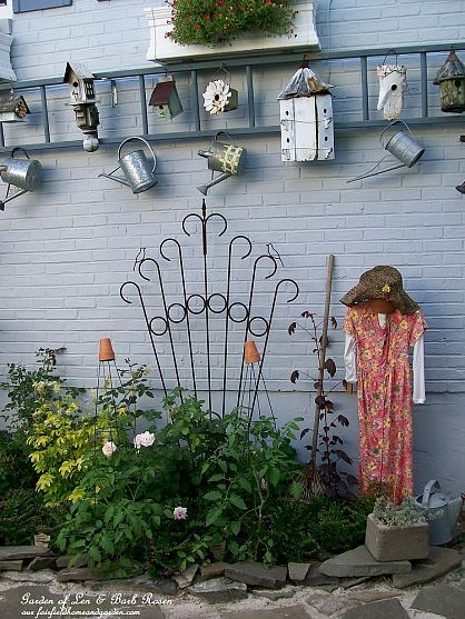 This vertical ladder anchors one of the most whimsical and fun garden vignettes that I have ever seen!