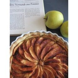 This is a marvelous apple tart that can be made in a pie plate or tart pan if you have one. A frangipane filling really brings together the flavors of fall, and the apples create a beautiful design.