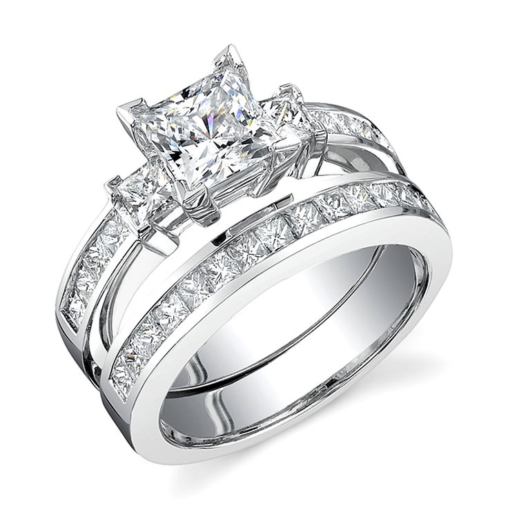 Beautiful ring! My ideal wedding set. Demonstrate your enduring love with this princess-cut diamond bridal ring set. Crafted of stunning white gold, this bridal set features a princess-cut solitaire diamond flanked by two matching side diamonds and a cluster of smaller brilliant diamonds.