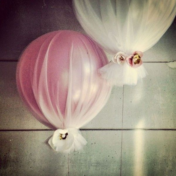 Cute way to use balloons for a wedding and making them classier. balloon + tulle. This is so easy looking and so beautiful, weighted down with magnets or something
