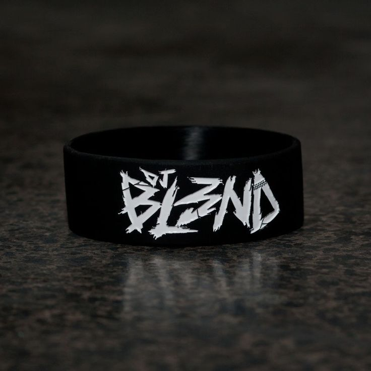 Black rubber wristband with DJ BL3ND logo embossed in white. #djbl3ndmerch #churchofmerch
