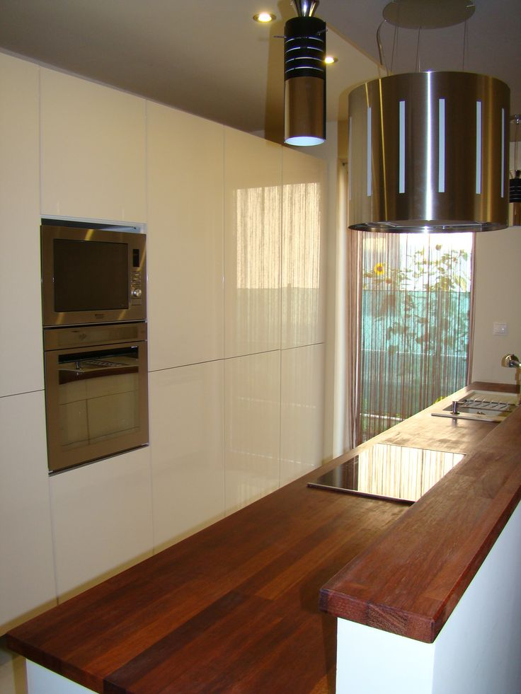 Contemporary white kitchen with merbau wood