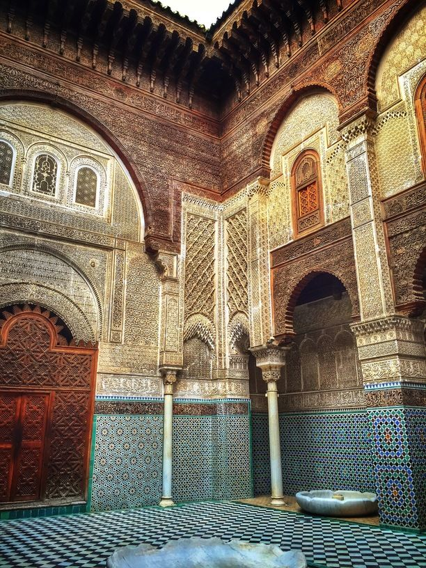 Al Attarine Madrasa, Fes, Morocco — by Malia Ann. This beautiful religious school, Al Attarine Madrassah, was built between 1323/1325 and is located in the amazing...