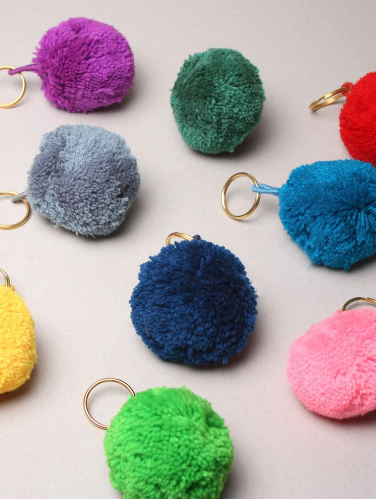 The Pom Pom Basic Keyring by Bohemia Design is a bright wool pom pom attached to a cotton thread loop and metal ring, handmade in India by artisans. This eye-catching pom pom keyring adds a fun twist