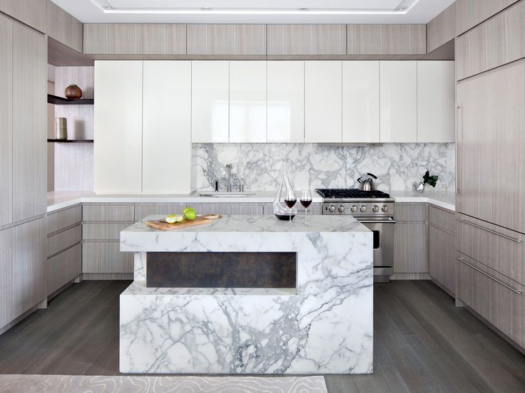 Polished Calacatta Marble On The Kitchen Island, Caesarstone Countertops,  And Custom Gray Wood Cabinetry