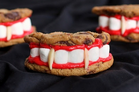 1 cookie split in half, marshmallows and red frosting