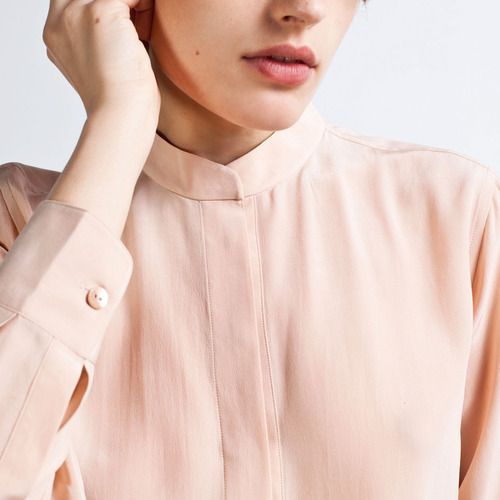 The new Silk collar is a take on the traditional mandarin style. Next to the covered placket, it has a modern simplicity that can pair with anything.