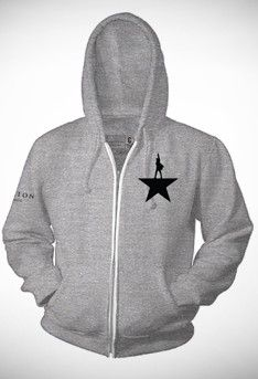 """This unisex grey zip hoodie is embroidered in black with the Hamilton Star logo over the heart and """"Hamilton An American Musical"""" on the the right sleeve. Warm and roomy for a comfortable fit over tees or light weight sweaters."""