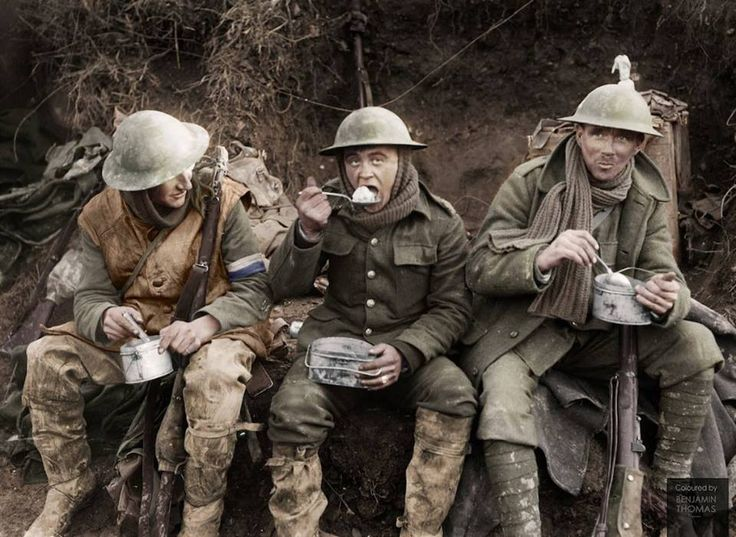 British soldiers eating hot rations in the Ancre Valley during the Battle of the Somme, October 1916.  Colorized by Benjamin Thomas.