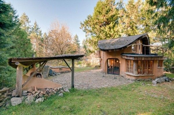 Check out this two-story fairytale cob cottage nestled in the woods of Mayne Island in British Columbia.