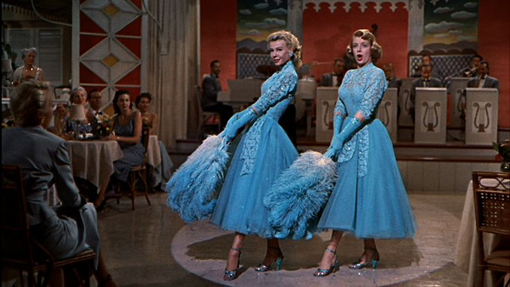 Vera Ellen & Rosemary Clooney - Sisters. This comes from a fantastic blog post about the life and schemes of Vera Ellen/Judy Haines. Click thru to read it - it's my favorite read of the year. And if you need some White Christmas tunes http://www.learnyourchristmascarols.com/2009/11/white-christmas.html