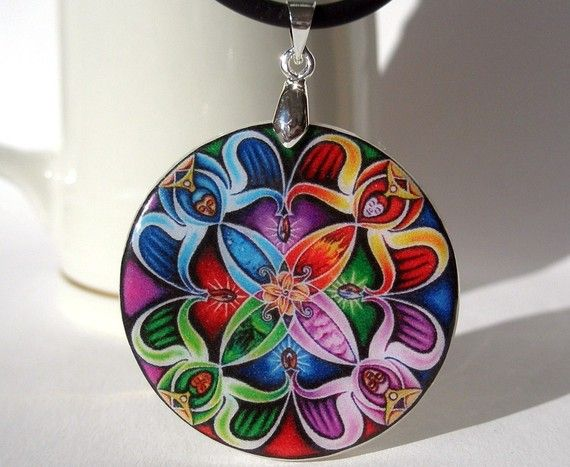 Handmade polymer clay amulet- so amazing 4 different color ways into one gorgeous cane.