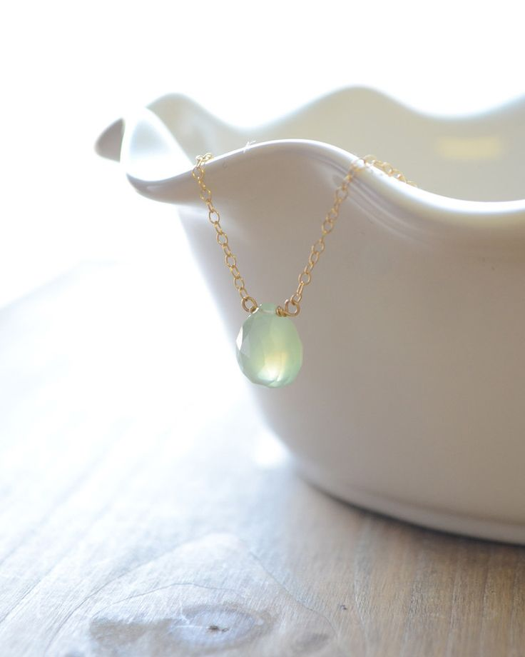 Soft Green Chalcedony Necklace by Olive Yew. Small light blue Chalcedony stone rests on a dainty gold, silver or rose gold necklace. The Chalcedony stone is believed to help create balance between mind, body and spirit.