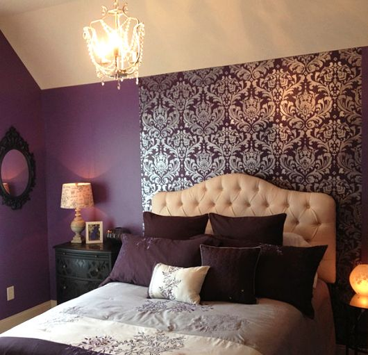 A purple bedroom with a DIY stenciled accent wall using the Anna Damask pattern. http://www.cuttingedgestencils.com/damask-stencil.html