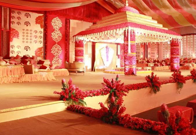 Design & Decor by Dinaz , decor , wedding decor , canopy , wedding , red , mandap , temple , south indian wedding , red roses , backdrop , stage , flowers , floral arrangements