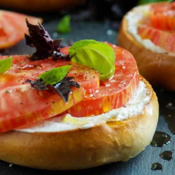 Toasted Bagel With Heirloom Tomato Crisp Toasted Bagels With Fromage Blanc Heirloom Tomatoes Sea Salt Basil And Oliv Starters Recipes Recipes Grilled Sandwich