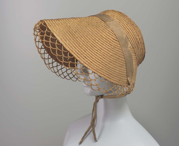 Bonnet | Museum of Fine Arts, Boston. Early 19th century. Worn Lexington, MA. Made US or England. Straw bonnet with deep brim, faded green ribbon sewn across top, open work edging. 99.664.97