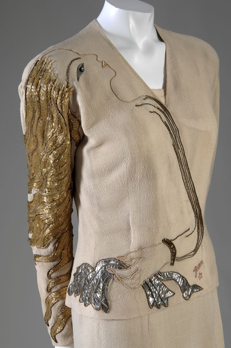 Elsa Schiaparelli - my favourite surrealist fashion designer...love the golden hair sleeve on this 1937 embroidered piece.